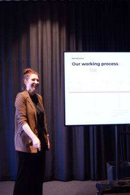 Red head girl presenting timeline and process of the project work